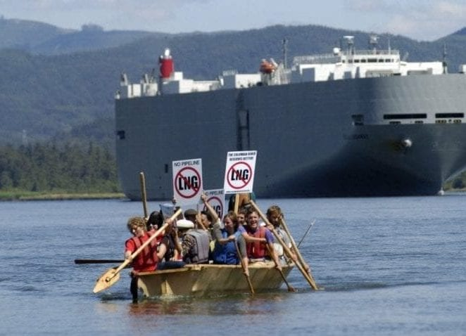 LNG protestors in row boat with large tanker in background