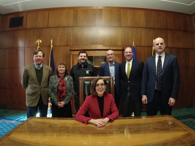 Group of people with Governor Kate Brown in an office.