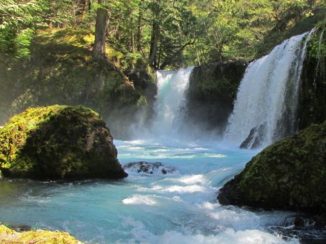 Waterfall splashing into a river