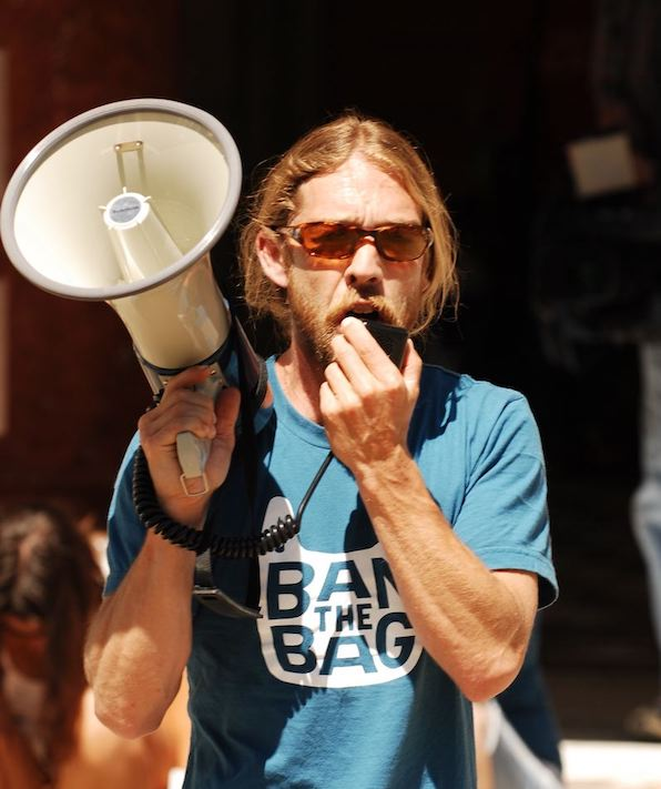 Charlie Plybon with a megaphone at a Ban the Bag protest