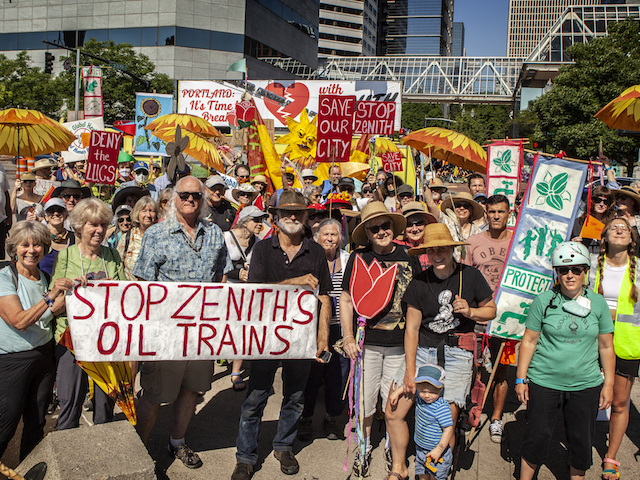 """Group of people holding signs """"Stop Zenith's Oil Trains"""""""