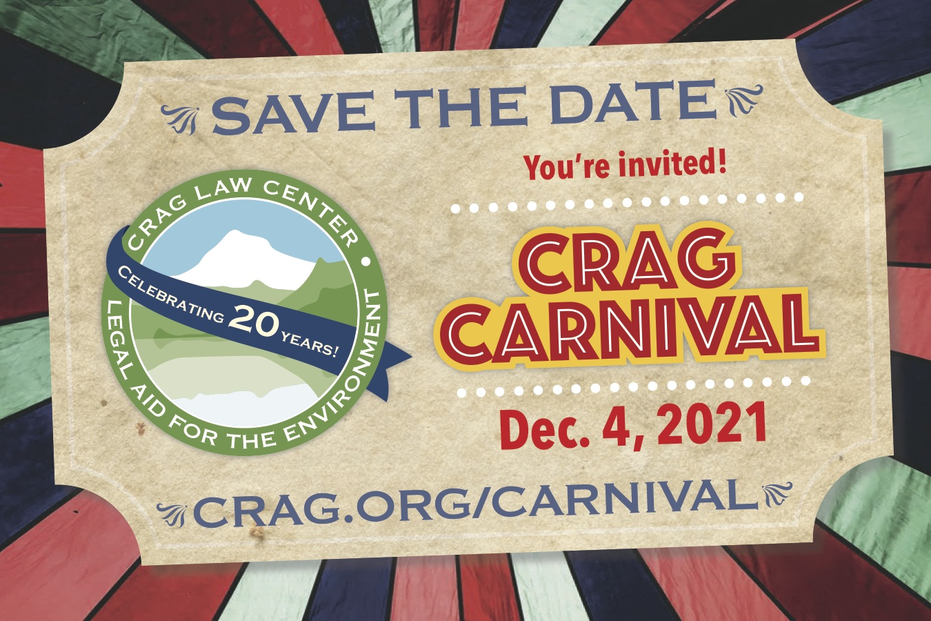 man in a top hat stanidng in front of multicolored striped tent with sign that reads Crag Carnival